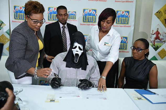 Lottery winner wears Scream mask to claim his prize so he won