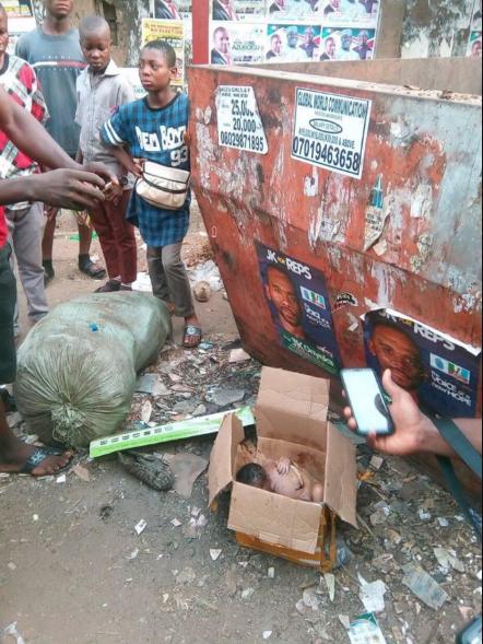 Newborn baby found dead in carton dumped by a refuse site in Anambra (disturbing photos)