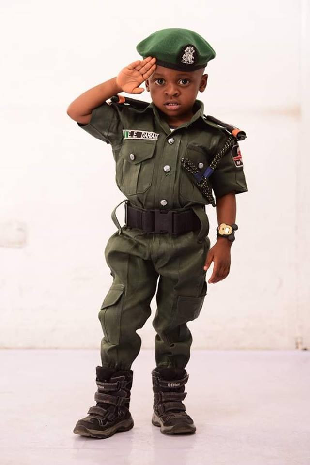 Little boy wows many with his mobile police themed birthday photos