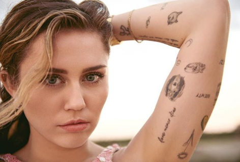 Miley Cyrus bares her boobs in multiple photos as she covers Vanity Fair