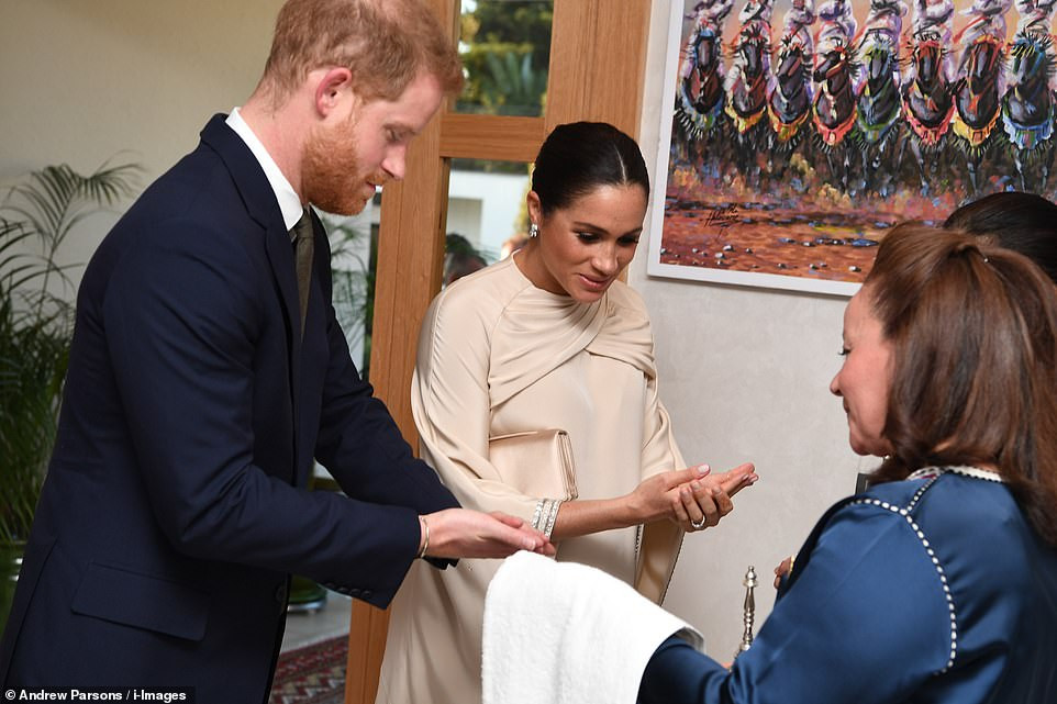 "Meghan Markle calls on women to ""challenge everywhere"" in feminist speech as she joins Prince Harry for British ambassador"