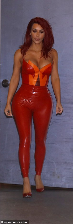 Kim Kardashian flaunts her cleavage and famous derriere in red hot PVC jumpsuit (Photos)