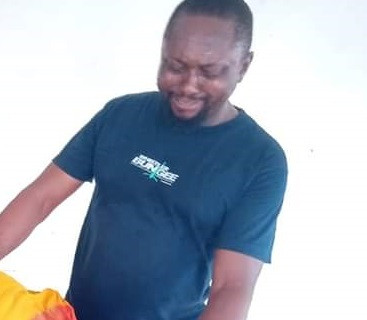 Heartbreaking photo of husband of late INEC staff crying over body of his wife killed during elections in Rivers state