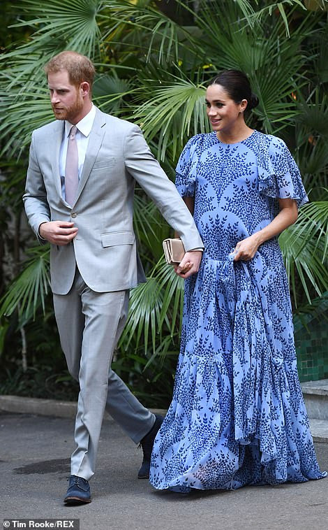Meghan Markle dons a blue gown as she joins her husband for a private meeting with King Mohammed VI on their last evening in Morocco