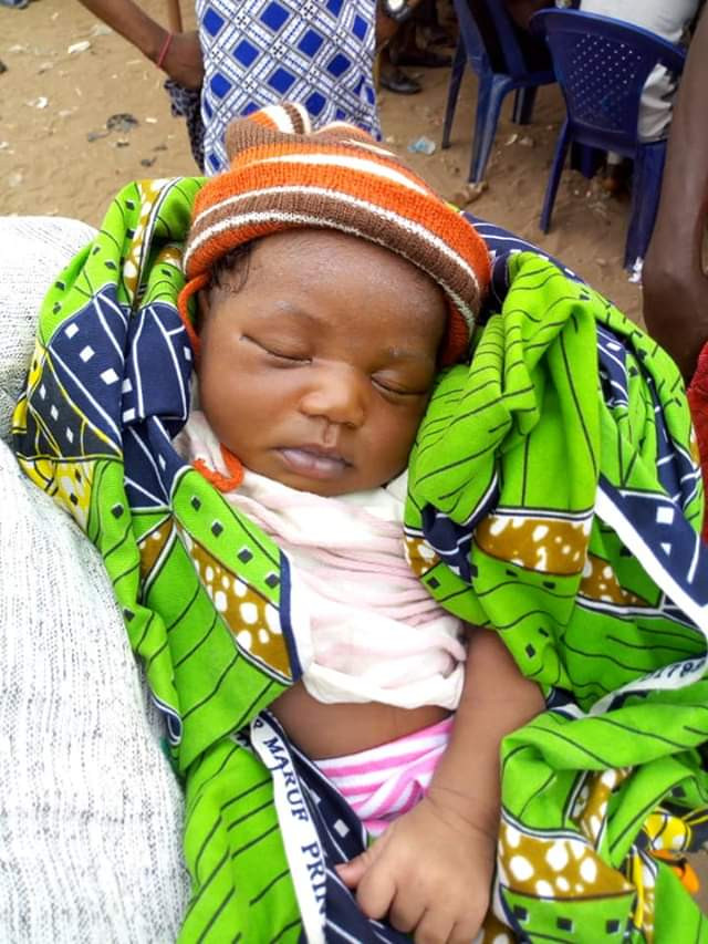 Photos of 9 day old baby who survived after alleged Fulani herdsmen killed her mother in Benue and left her father fighting for life