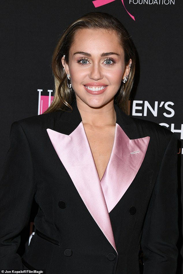 Miley Cyrus and husband Liam Hemsworth suit up for Beverly Hills breast cancer benefit Gala (Photos)