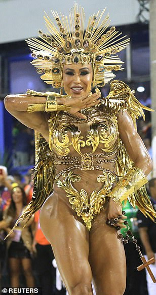 See photos from Rio de Janeiro carnival as thousands of Brazilian dancers parade their assets in sparkly G-strings