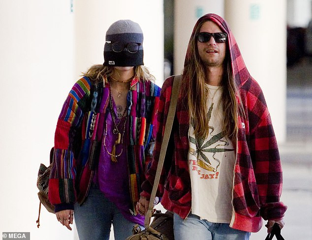 Paris Jackson hides her face with hat as she is seen for the first time after paedophile accusations against her father Michael surfaced (Photos)
