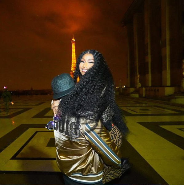 Nicki Minaj shares loved-up photos with her man as they pose together in?front of the Eiffel Tower?