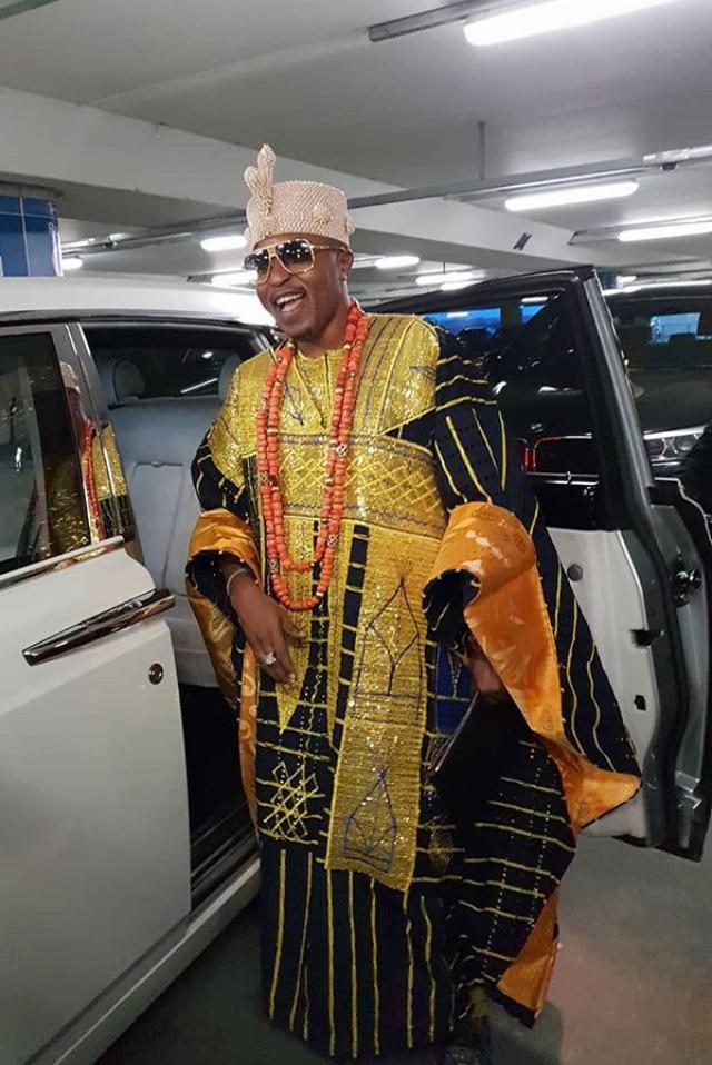 Flamboyant Nigerian monarch, Oluwo of Iwoland, Rasheed Akanbi, boasts about white man holding umbrella over his head as he arives London in style