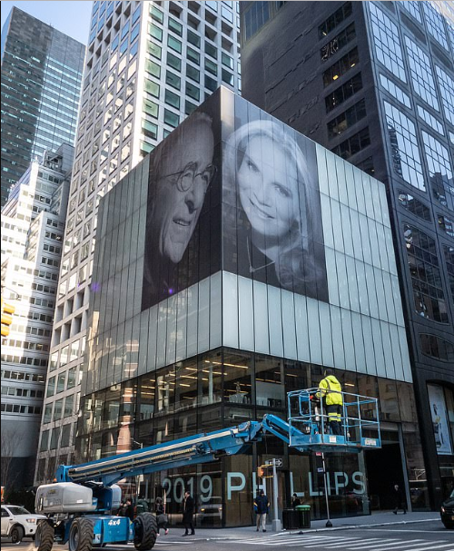 US Billionaire taunts ex-wife by putting up giant photographs of himself and new wife on a tall building after their messy divorce?(Photos)