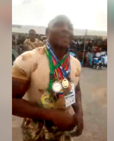 Nigerians unimpressed as soldier lays on the  ground and allows military vehicle climb over him during Army Heavyweight Champion Display (video)
