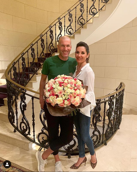 Real Madrid coach, Zinedine Zidane gives flowers to wife Veronique as they celebrate their 25th wedding anniversary (Photo)