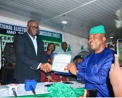 Photo:?Imo state Governor elect, Emeka Ihedioha receives his Certificate of Return from?INEC