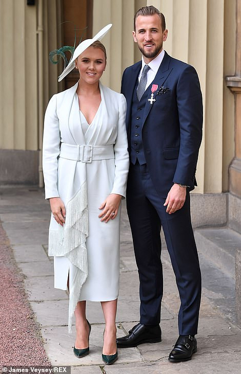 Striker Harry Kane receives his MBE from Prince William at Buckingham Palace after leading England to the World Cup semi-finals (Photos)