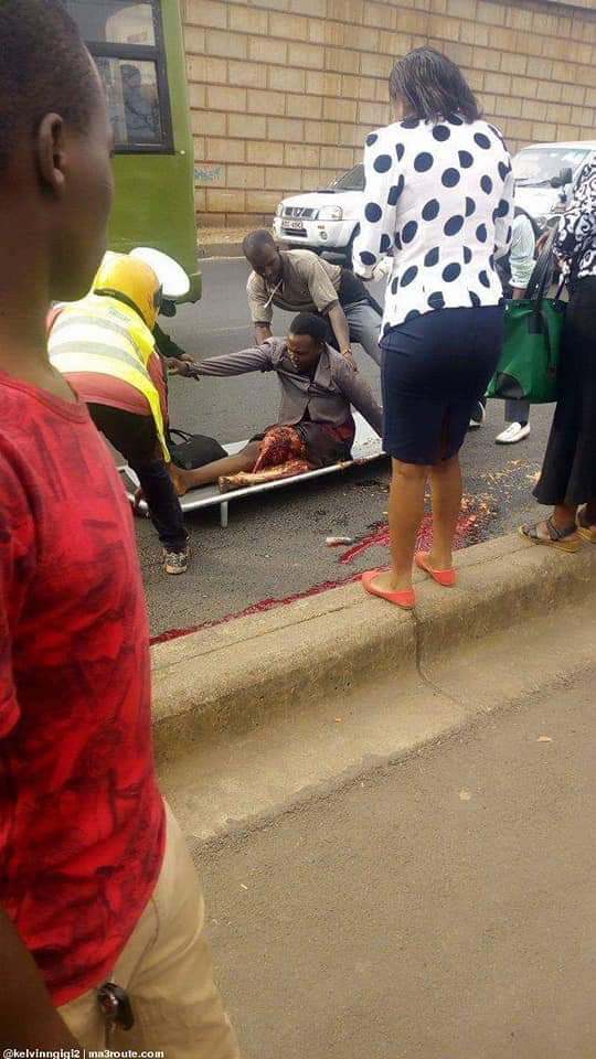 Graphic Photos: Bus driver runs over a woman while trying to escape from traffic police