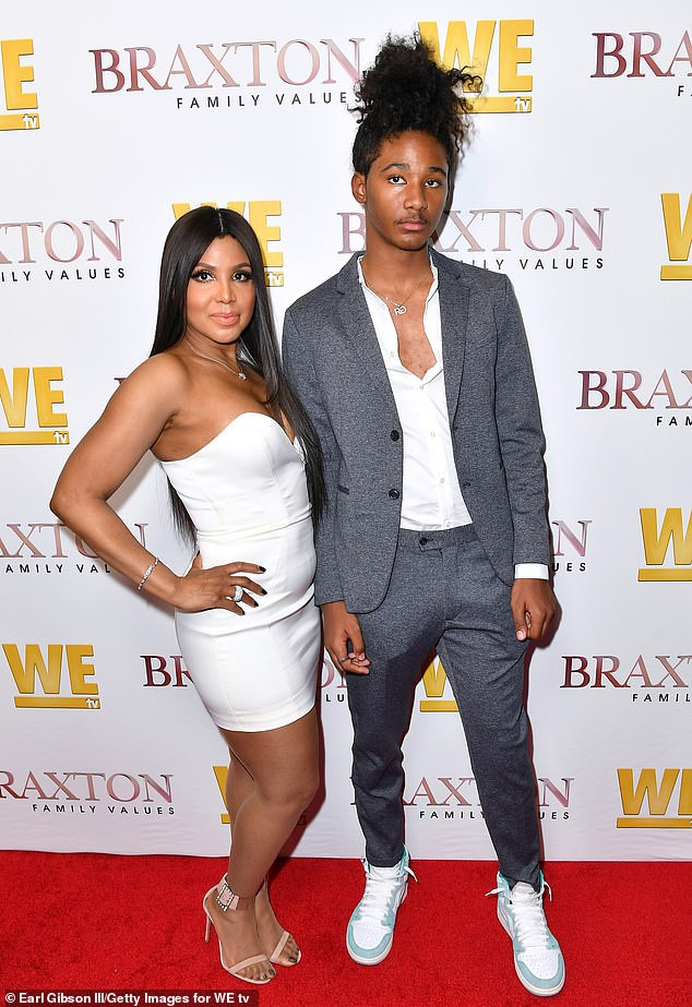 Toni Braxton plants a sweet kiss on her son Diezel, 16, as they step out together for Braxton Family Values premiere (Photos)