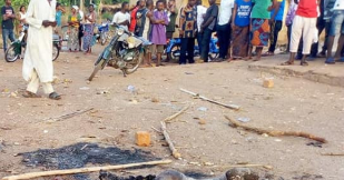 Graphic Photos: Suspected armed robbers burnt to death in Benue