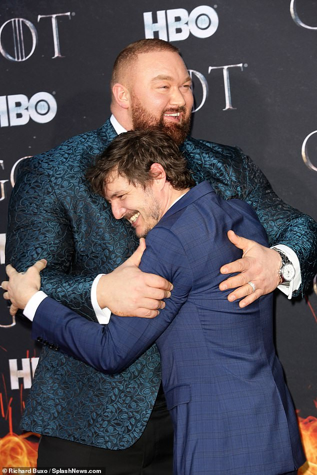 Games of Throne star, The Mountain, towers over his wife Kelsey Henson as they attend Season 8 premiere (Photos)