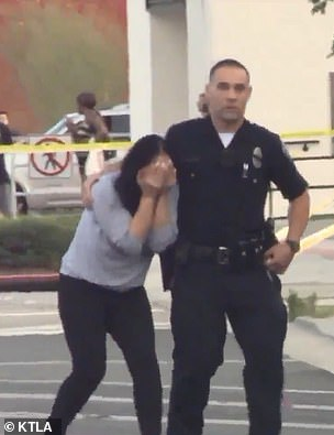 Father fatally shoots the mother of his child in front of police station during custody exchange