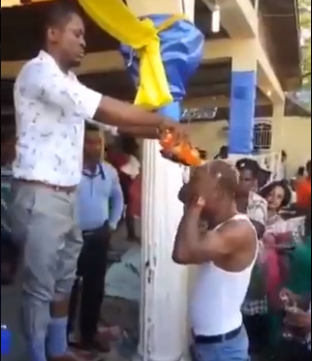 Pastor bathes his members with bottles of soft drinks which he calls anointing soda (video)