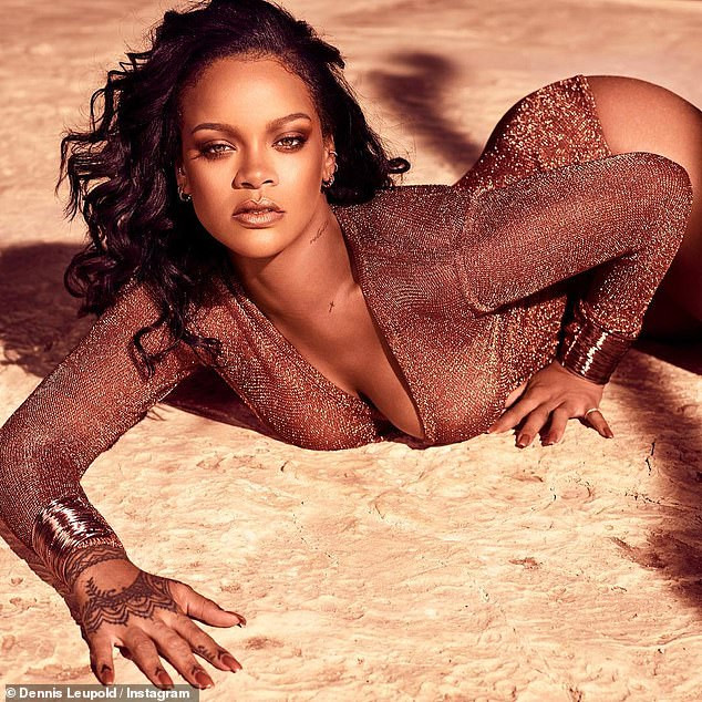 Rihanna strikes suggestive pose in a low-cut leotard (Photos)