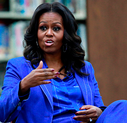 Michelle Obama comes under fire for comparing President Trump to a divorced dad
