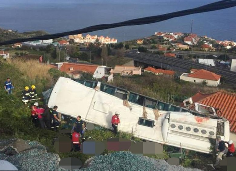 At least 29 dead as tourist coach topples off mountain road on Portuguese Island