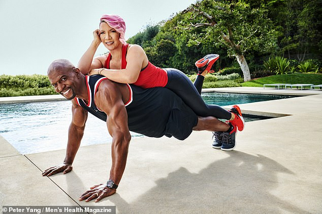 Terry Crews shows off his impressive massive muscles as he covers Men