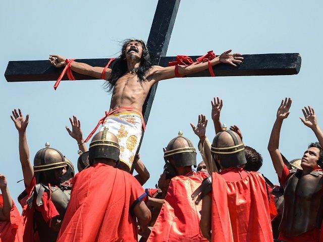 17 Filipino devotees including a woman nailed to crosses as they re-enact the crucifixion of Jesus on Good Friday  (Photos)