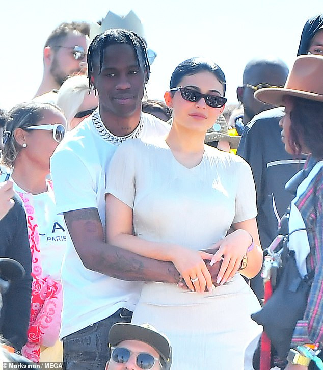 Kylie Jenner and Travis Scott share kiss during Kanye West