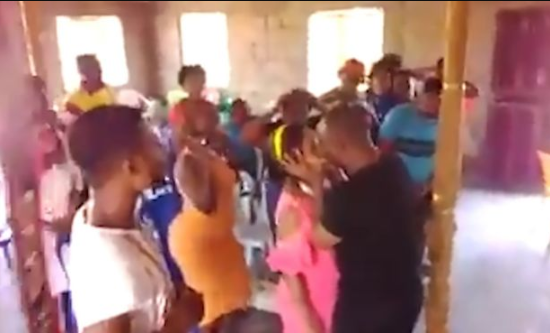 Pastor locks lips with young woman for very long time to