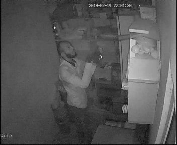 Photos: CCTV camera records an unidentified man stealing from a pharmacy in Ibadan