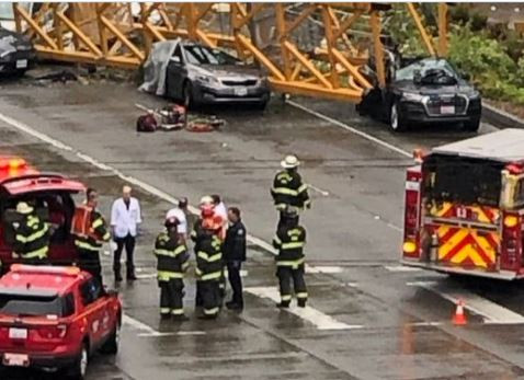 Construction crane falls on vehicles in Seattle, killing two workers and two people