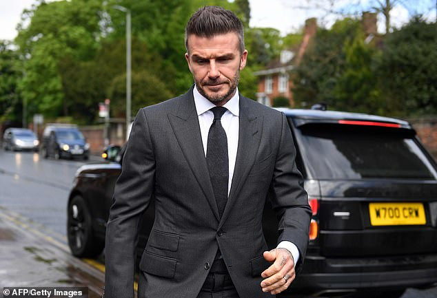 David Beckham is banned from driving for 6-months and hit with a ?750 fine after being caught using his phone while driving (Photos)