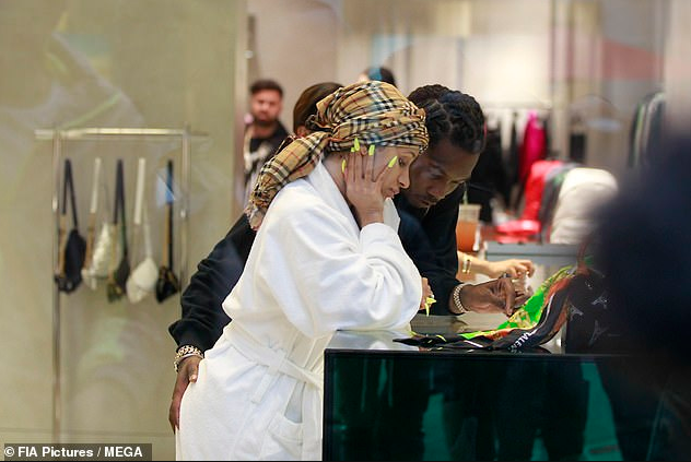 Cardi B seen in public again in a dressing gown and scarf