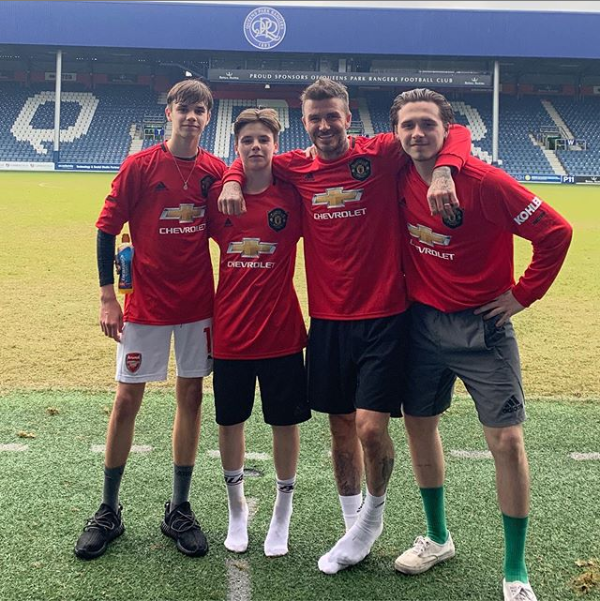 Football legend, David Beckham and his three sons pose in new Manchester United jerseys?