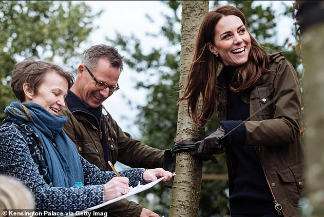 Kate Middleton shows off her playful side as she poses in the garden she designed for the Chelsea Flower Show