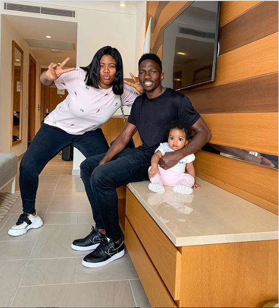 Cute family photo of Kenneth Omeruo, his wife Chioma and their daughter, Chairein?