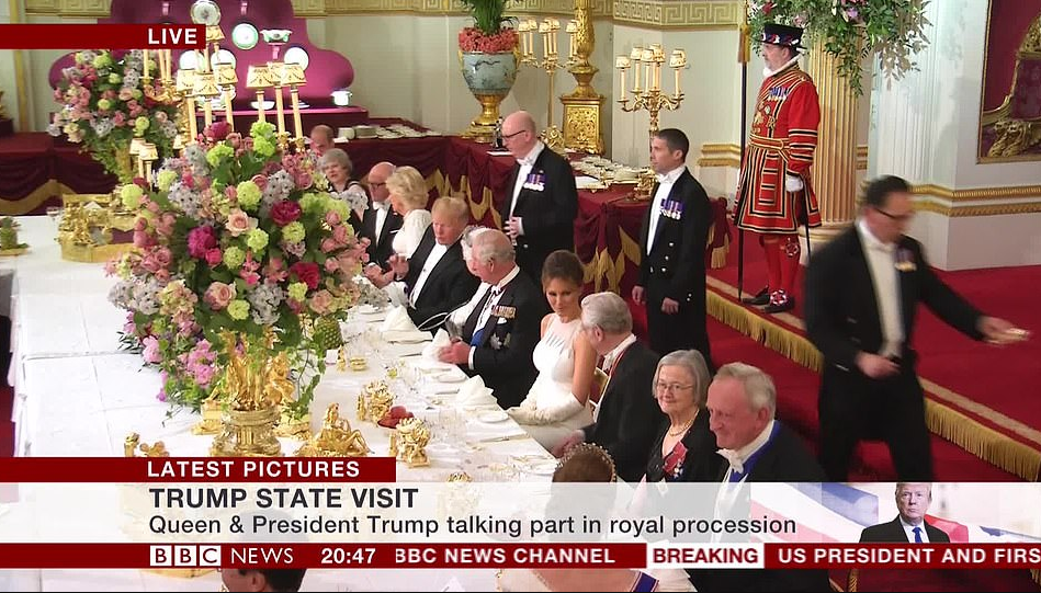 Donald Trump, Melania Trump, and Ivanka Trump pictured with members of the royal family at State Banquet holding at the Palace