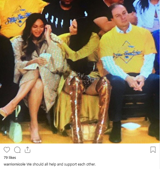 Woman leaning over Beyonce at game shares photo of her and Bey to show they are good but the Beyhive are not appeased