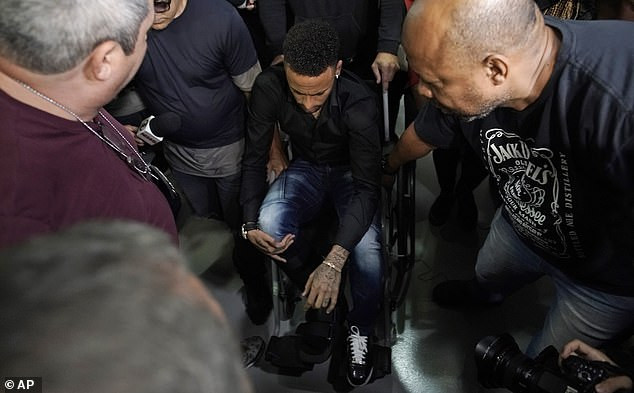 Brazil football star Neymar arrives at police station in a wheelchair for questioning after being accused of rape (Photos)