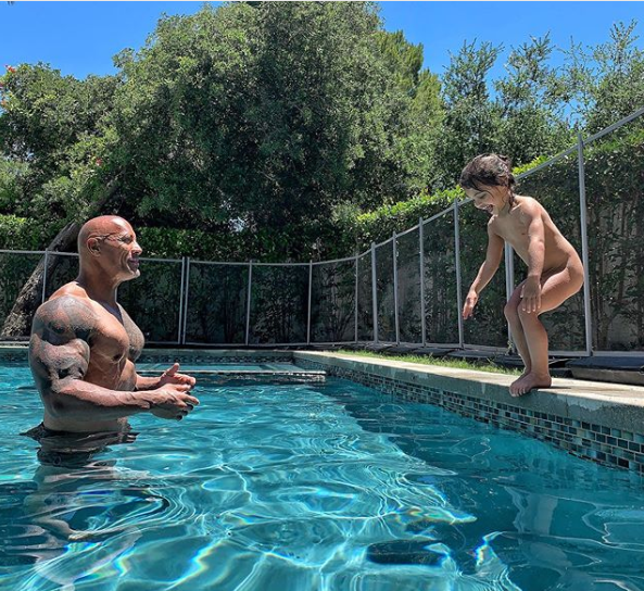 Dwayne Johnson shares photo of his 3-year-old daughter unclad as he teaches her how to swim but internet users think it's wrong (Screenshots)