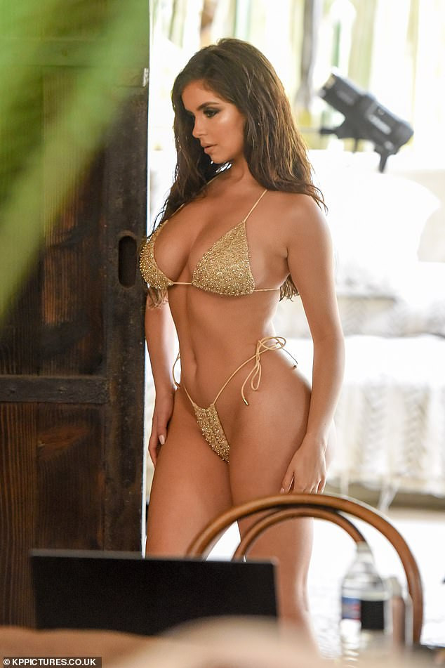 Demi Rose strikes a range of sultry poses in skimpy gold bikini just a day after she lost her mother  (Photos)