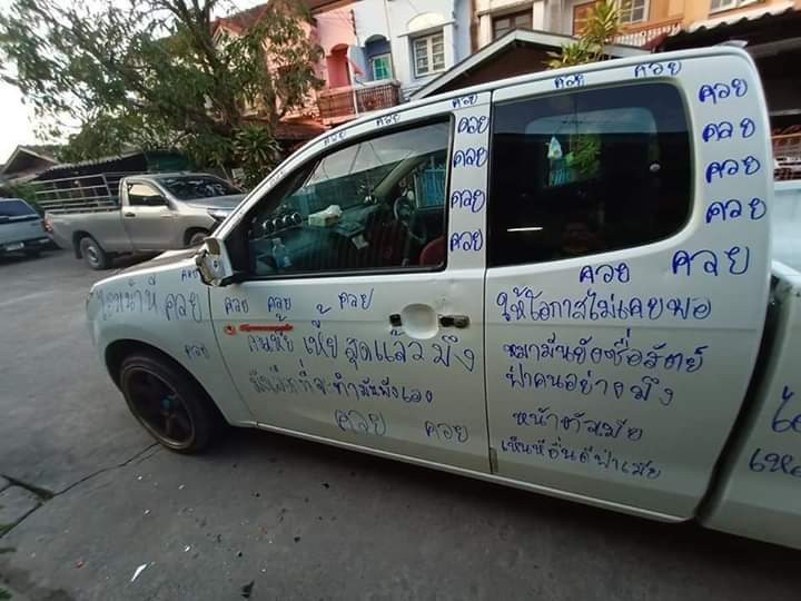 Angry wife takes revenge on her unfaithful husband by scribbling displeasing messages all over his pick-up with magic marker