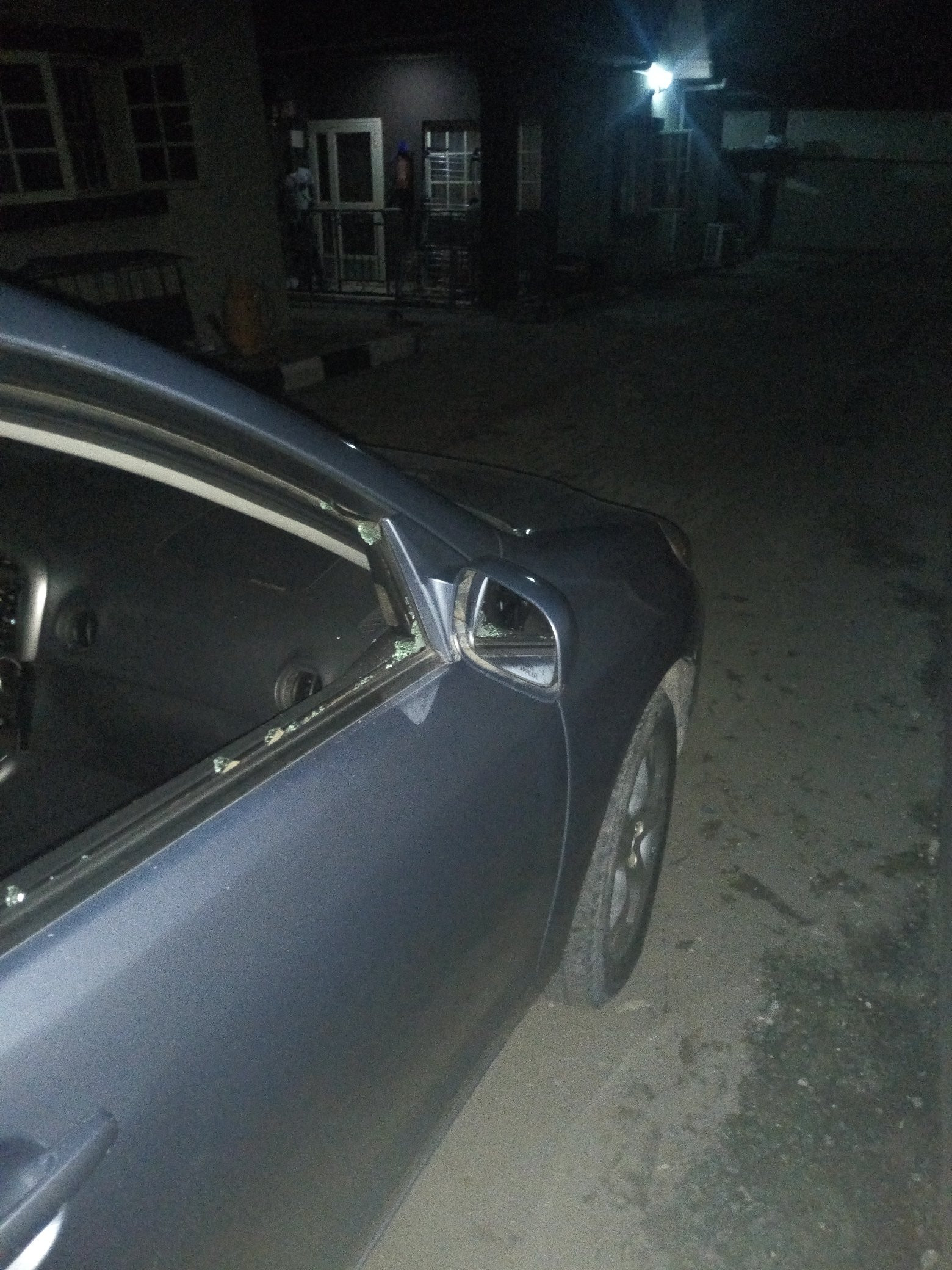 Lagosian narrowly escapes death after robbers shoot at her car on Eko bridge
