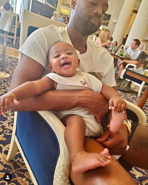 Daddy Duties! Dwyane Wade bottle feeds his daughter, Kaavia? (Photos)