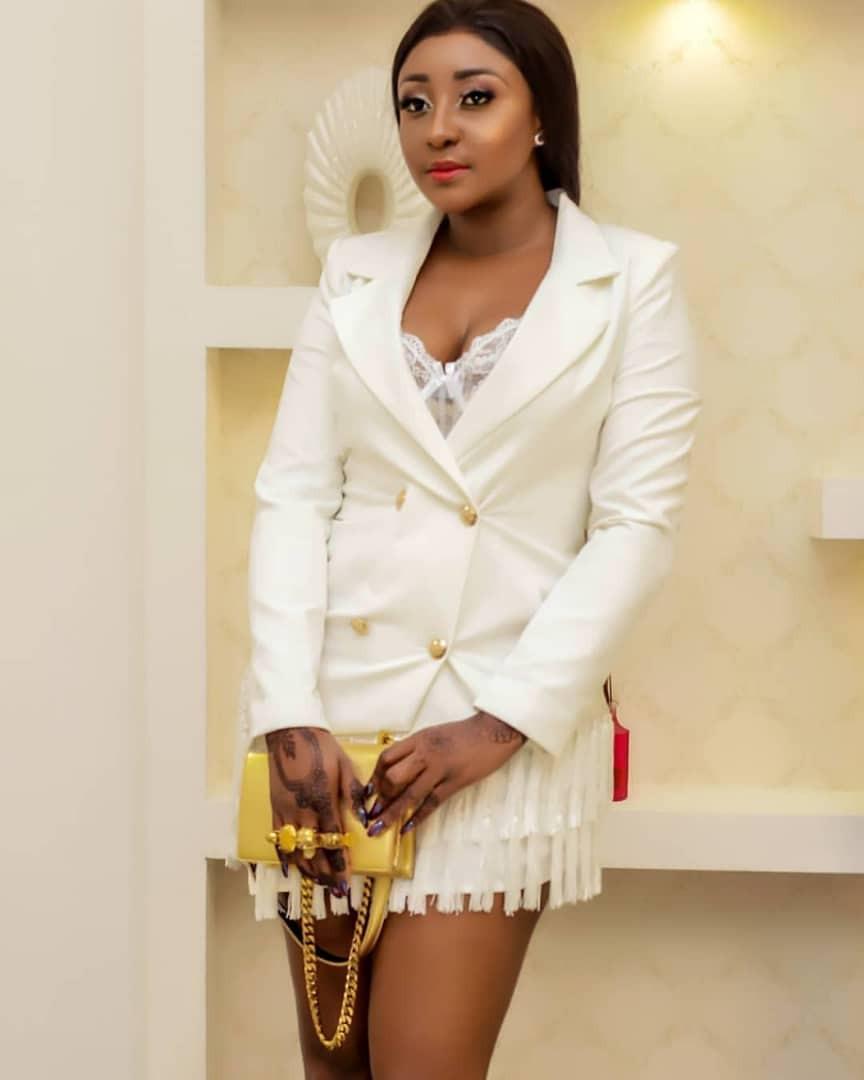 Ini Edo stunning in white and gold ensemble
