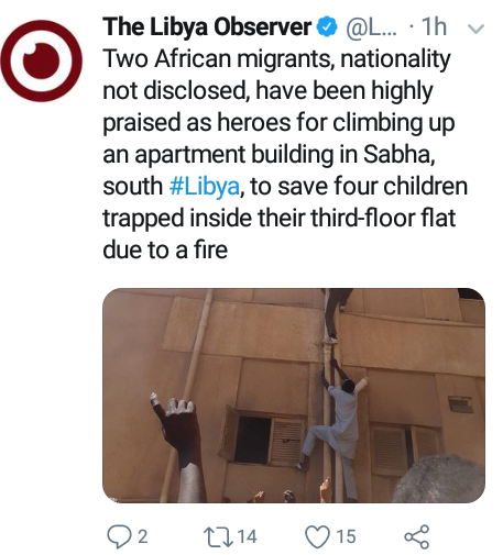 Photo: Two African migrants hailed as heroes for climbing up a building in Libya to save four children trapped inside burning third-floor flat
