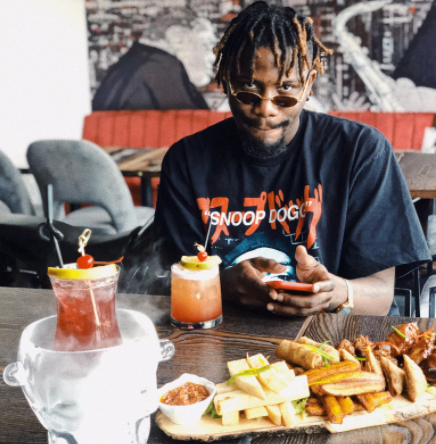 Y Cee sarcastically replies a fan who questioned his source of income